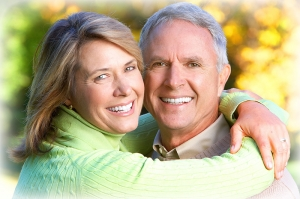 upcc elderly couple smiling embracing